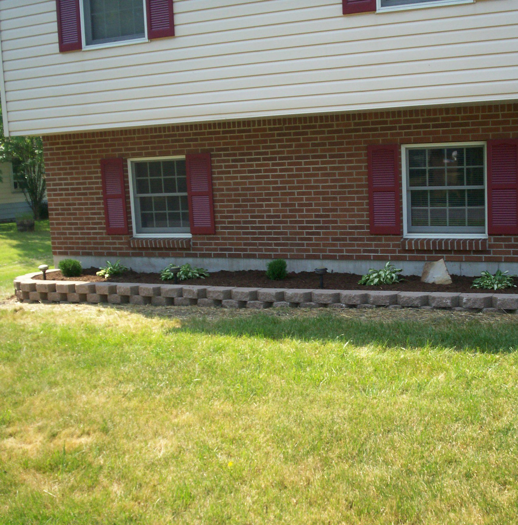 partial brick house, flowerbed, lawn care